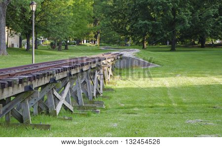 A Train bridge in a local city park designed to allow a small train to travel with people who are site seeing