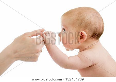 Baby infant holds mother's hand isolated over white