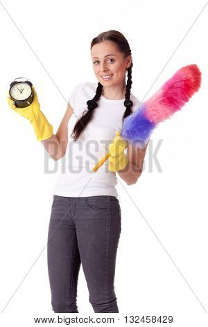 Young woman with alarm clock and whisk on a  white background.  Housekeeping.