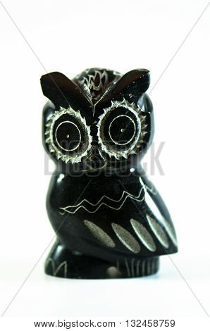 Basalt stone carved Owl on white background