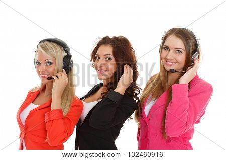 Happy young business women with headset on a white background. Operators of support service.