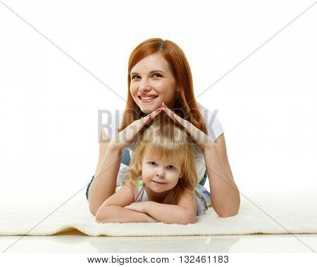 Happy mother with sweet little daughter lay on a white background. Concept of care and protection.