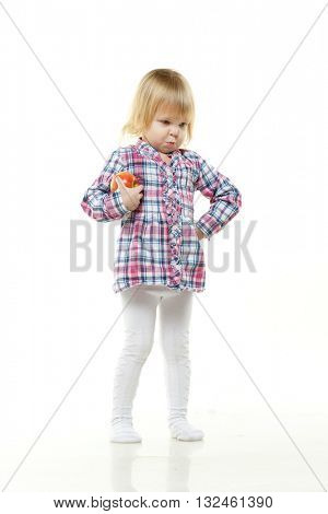 Sweet small girl with fresh apple on a white background. Healthy food.