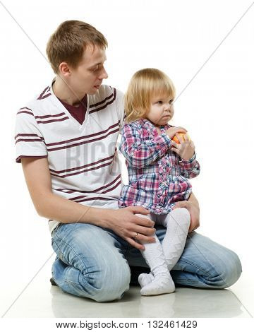 Young father and little child with apple on a white background. Happy family.