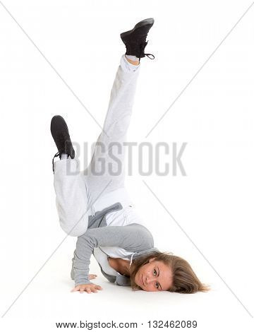 The beautiful sporty girl dancing on a white background. Modern dances.
