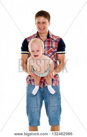 Young father with baby are doing gymnastic exercises, holding baby in hands on a white background. Healthy lifestyle.