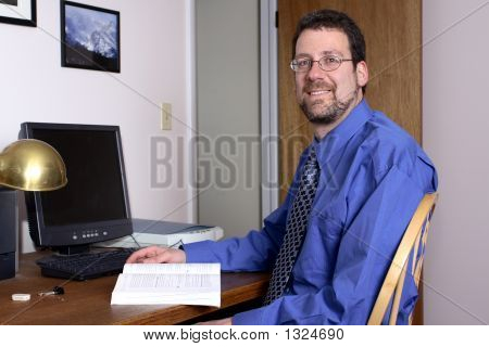 Middle-Aged Man Interrupted At Work