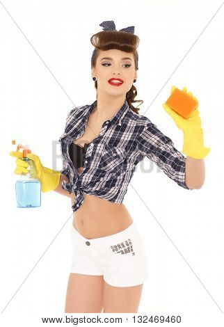 Young woman with spray bottle and sponge on a  white background.  Housekeeping. Cleaning woman.