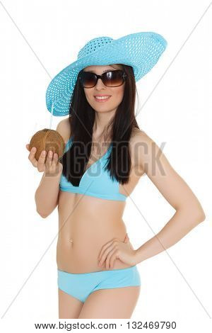 Portrait of young beautiful woman in bikini and sunhat with cocktail in coconut  on a white background. Tropical vacation.
