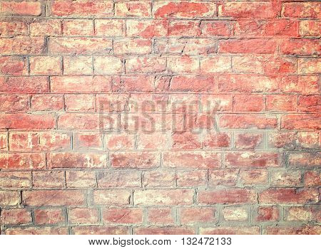 Background with Old Yellow- Red Brick Wall Covered in Peels which Makes Specific Texture