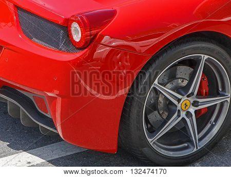 DUBAI, UAE - MAY 15, 2016: close up of Ferrari 458 Italia on road in Dubai