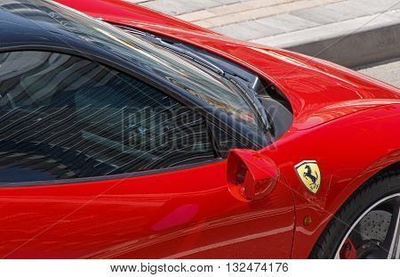 DUBAI, UAE - MAY 15, 2016: close up of Ferrari 458 Italia on road in Dubai