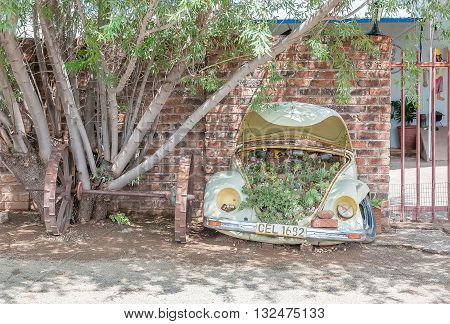 GARIEPDAM SOUTH AFRICA - MARCH 8 2016: An unusual succulent garden and wagon axle and wheels in Gariepdam town in the Free State Province