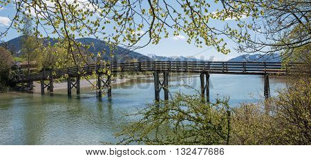 Wooden Bridge Over Mangfall River, View To Lake Tegernsee