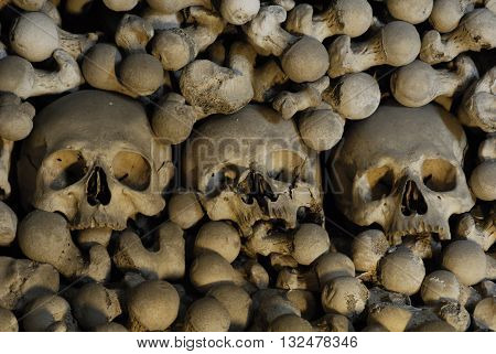 Close up detailed view of skulls in Sedlec Ossuary, Church of Bones in Kutna Hora, decorated with real human skeleton bones.