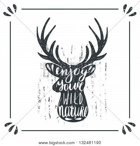 Hand drawn doodle wild deer silhouette with lettering quote enjoy your wild nature. Card postcard background with deer
