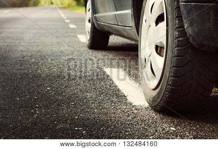 car tires on asphalt road with a dividing line