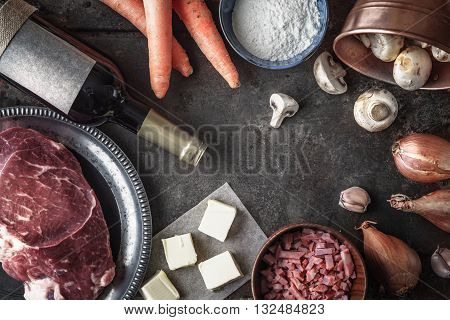 Ingredients for Boeuf Bourguignon on the old metal background top view