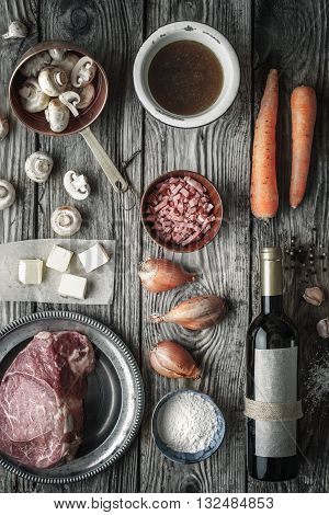 Ingredients for Boeuf Bourguignon on the old wooden table top view