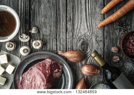 Ingredients for Boeuf Bourguignon on the old wooden table horizontal