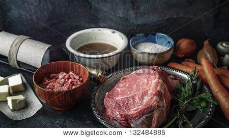 Ingredients for Boeuf Bourguignon on the dark stone table horizontal