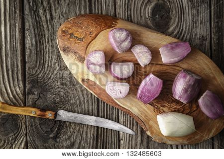 Sliced shallot on the wooden board top view