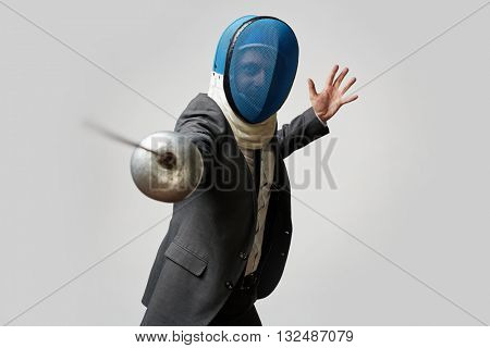 Businessman with fencing foil