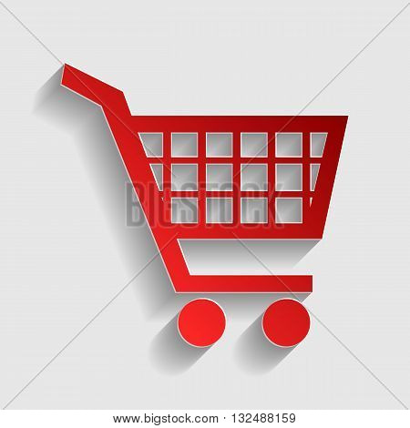 Shopping cart sign. Red paper style icon with shadow on gray.