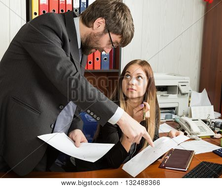 relations between superiors and subordinates. Angry boss screaming to his employer woman and she is surprised and shocked.