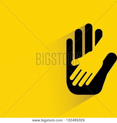 helping hand with drop shadow on yellow background