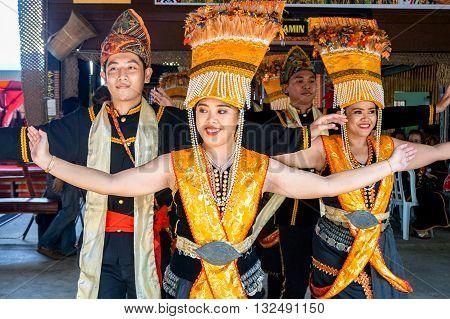 Penampang,Sabah-May 30,2016: Women of Kadazandusun ethnic in their traditional costumes dancing for the public during Harvest Festival on May 30,2016 at Hongkod Koisaan KDCA Penampang,Sabah,Malaysia