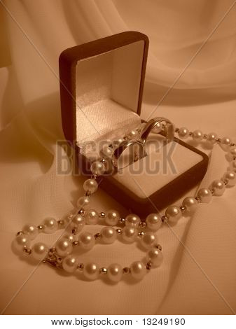 Wedding rings and pearl necklace
