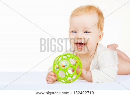 Beautiful blue-eyed baby with ball isolated on white background