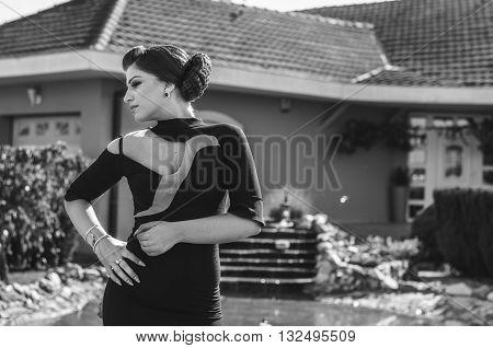 Beautiful young woman wearing a formal dress