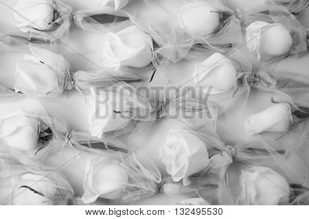 Rose bouquets beautiful fresh flowers in tulle fabric black and white on whiten background