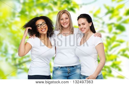 friendship, diverse, body positive and people concept - group of happy different size women in white t-shirts hugging over green natural summer background