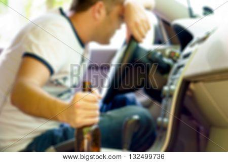 Drunk man sleeping in the car blurred