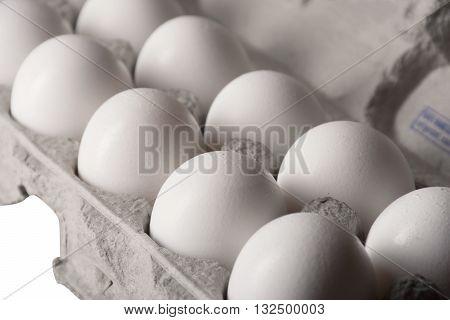 Closeup of eggs in an egg carton.
