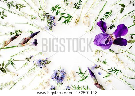 floral frame with purple iris flower lily of the valley branches leaves and petals isolated on white background. flat lay overhead view