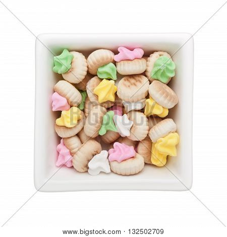 Iced gem biscuits in a square bowl isolated on white background