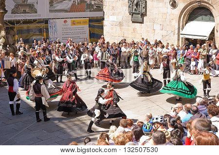 Santiago de Compostela, Spain - 2 June 2011: folk dancing in the square with traditional costumes and the public in Santiago June 2011