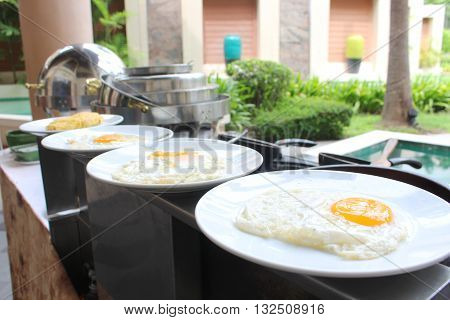 row of the fried egg on the plate ready to serve