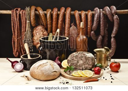 Assortment of meats, with bread, vegetables, pickled cucumbers, lard and spices