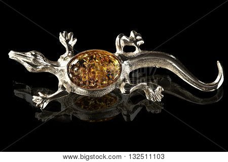 silver and amber brooch Lizard on black background