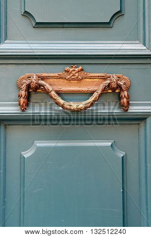 Luxury vintage door handle on a turquoise painted door in France