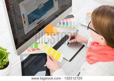 Graphic designer at work. Color swatch samples.
