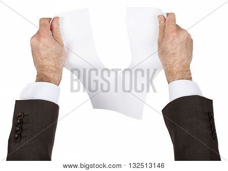Businessman tear blank paper isolated on white background