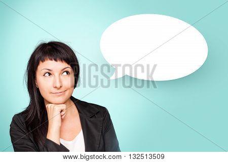 Beautiful young woman holding hand on chin having briliant idea.