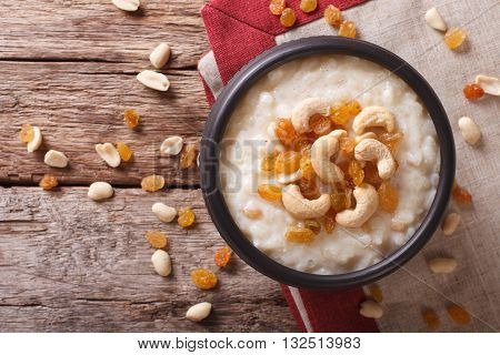 Tasty Rice Pudding With Nuts And Raisins Close-up. Horizontal Top View