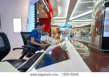 DUBAI, UAE - MARCH 09, 2016: Dubai International Airport staff. Dubai International Airport is the primary airport serving Dubai, United Arab Emirates